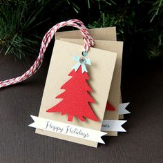 Our Christmas Tree Tags are the perfect finishing touch for your holiday packages. Affix them to gifts, goodie bags. wine bottles or other holiday treats. Each one features a raised Christmas Tree and message banner* affixed to a recycled Kraft mat. The back is left blank for message writing.  *choice of Merry Christmas, Happy Holidays, Seasons Greetings or Tis the Season  DETAILS... • 6 printed tags • Tags measure 2 x 3 • Blank on flip side for message writing • Holes pre-punched •…