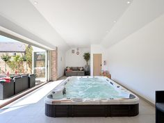 - Indoor swimspa seats 12 people with bifold doors leading out onto the patio