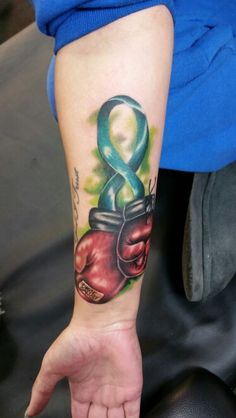 A cervical cancer ribbon tattoo performed by Trap Wright....  #cervicalcancer #hope #fight #boxinggloves #tattoo #customtattoo #cooltattoos