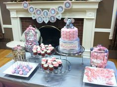 Pink & grey, elephant themed 1st birthday complete with elephant cake, mini cupcakes, cake pops, elephant lollipops and don't forget the peanuts!