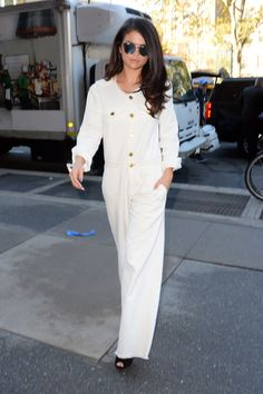 In a white jumpsuit while in New York.    - HarpersBAZAAR.com