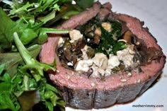 Flank Steak Stuffed with Spinach, Capers and Feta. (Suggestion: Score both sides of the steak before pounding. Add a layer of seasoned toasted bread dice. Wilt spinach and squeeze out water. Use French feta (milder). Think about omitting the capers. Add chopped black olives. Brown all sides in 1 Tbsp. oil. Set into marinara sauce and braise for 2 -  2 1/2 hours or in a slow cooker on low for 6 - 8 hours.