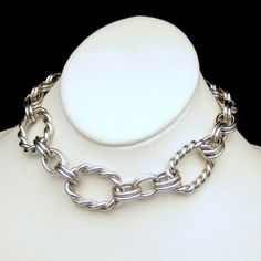 CHUNKY SILVERTONE TWISTED ROPE LINKS! If you love chunky jewelry, but don't like the heavy weight, this vintage necklace is for you. The open links keep the necklace light while preserving that great bold look. $125