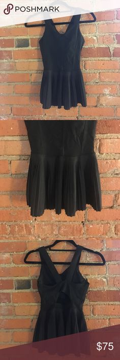 Lululemon black pleated city tank size 6 Black pleated city tank with built in bra, size 6. Worn twice. The tag and built in bra pads are missing, otherwise excellent condition. lululemon athletica Tops Tank Tops