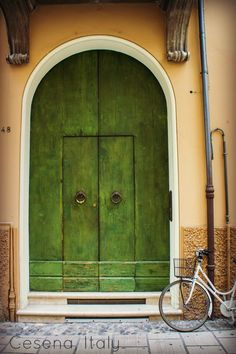 Door and Bike in Cesena, Emilia-Romagna, Italy