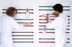 Use Droog straps to hang flats and sandals on your wall.