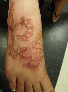Art nouveau style floral tattoo. tattoo-inspiration (I really like how brown tattoos turn out. Maybe I can do something similar on my left foot?)