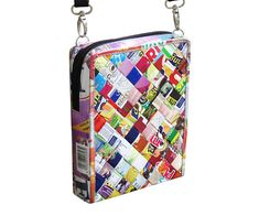 This small zip crossbody bag is made using candy and snack wrappers. Folded into strips and woven tightly. It has a zipper closure and adjustable length strap made of vinyl. Perfect size for all types of cellphones.  Features: YKK top closure zipper Polyester fabric for lining. This bag has no inner pockets.  Dimensions in inches: Height 8, Length 6, Thickness 1.7  Dimensions in centimeters: Height 20 cm, Length 15.5 cm, Thickness 4 cm  Maximum strap length 52 (25 drop down) --- In…