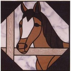 "HORSE STAINED GLASS PATTERN - This stained glass wallhanging quilt pattern is 23"" x 23"" of a horse head at a fence railing with the sky in the background. Designed by Edna Trunt"