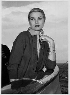 gracefilm: I love Constitution photos. The caption reads: A starry-eyed Grace Kelly stands on the deck of the liner Constitution watching the shore lights of France skip past. Today (12.4.56) she is due to leave the ship for Monaco, where, in a blaze of world-wide publicity, she is to marry Prince Rainier on Wednesday, 18th April. Her bracelets☺☺☺