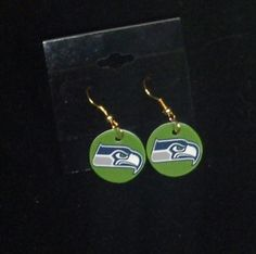 DEADLIEST CATCH BERING SEA TIME BANDIT SEAHAWKS FAN JEWELRY  Pick from one of the three designs pictured! This listing is for one pair of earrings. These are completed items and ready to ship. They are