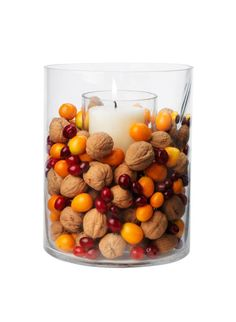 IFC Thanksgiving Dinner Simple Centerpiece Ideas: natural combo of walnuts, cranberries, and kumquats Thanksgiving Centerpieces, Simple Centerpieces, Thanksgiving Crafts, Fall Crafts, Fall Centerpiece Ideas, Hurricane Centerpiece, Thanksgiving Table Centerpieces, Thanksgiving Flowers, Cranberry Centerpiece