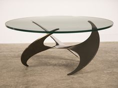 Propeller Coffee Table, Knut Hesterberg, Roland Schmitt, Germany 1964. The design team of Knut Hesterberg and Roland Schmitt came up with the iconic design of this singular table base. This table possesses a dynamic and graphic appearance because of its stunning sculptural profile. The table base began as a flat piece of circular aluminum before having three circular medallions removed equidistantly situated around the perimetre. The metal was then heated and torqued to achieve the sense of…