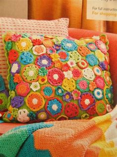 ...if I could crochet, I would make this...if i found it for sale, I would buy this...looking at something as simple as a pillow, making me this happy means I should have it!!!