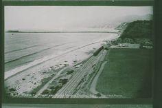 Railroad train travels past Santa Monica Canyon to the Long Wharf, 1885