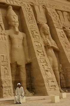 Temple guardian before the larger than life Ramses, Egypt by Raphael Bick on Flickr