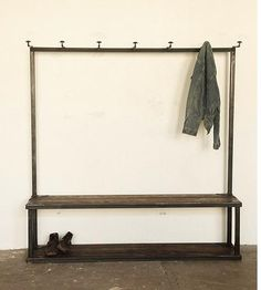 I love the minimalism of this coat rack but I don't think it would look very minimal filled with all my stuff