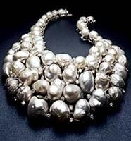 Tony Duquette Pearl and Diamond Necklace    bib-style necklace contains 62 Baroque South Sea pearls and 29 carats of diamonds, and is set in white gold