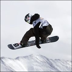 Snowboarding... and would love to meet Shaun White one day.