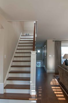Bright and fresh stairway that was repainted by Warline Painting Ltd.