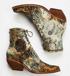 Grove Lace-Up Western Boot n a bold design, these fabric ankle boots with lace-up detailing. Pointed toe with western-inspired stacked heel and metal grommets.