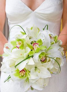 White lilies greencybidium orchids bear grass loops stunning brides bouquet/ www.callaraesfloralevents.com