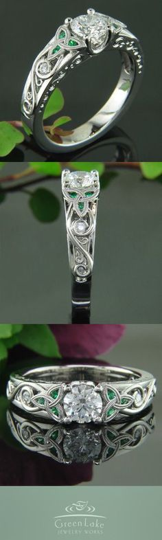 Custom diamond and palladium ring with double milgrained trinity knots encasing emeralds.: