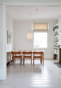 simple dining room with beautiful bones
