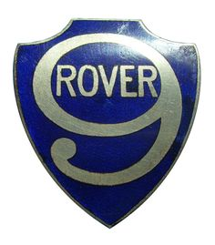 This is a rare antiquated 1926 Rover 9/20 radiator blue badge. It measures 47mm tall and has no fixings.  Made by WM MILLER,