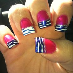 Ink-A-Dink-A-Pink by Nicole by OPI with a blue purple shade from OPI. And white accent nails. Also white tiger stripes.