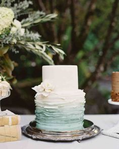 Trending Now: Deckle-Edged Wedding Cakes   Martha Stewart Weddings - Lisa Dupar & Company went all out on this deckle-edge wedding cake. A similar blue-and-white confection would be the perfect fit for a nautical reception.