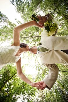 A unique perspective of a wedding day kiss between the Bride and Groom.