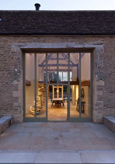 Architecturally striking barn conversion in the Cotswolds http://onekindesign.com/2016/05/18/striking-barn-conversion-cotswolds/?utm_content=buffer17989&utm_medium=social&utm_source=pinterest.com&utm_campaign=buffer