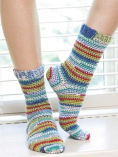 So comfy and soft, hand-crocheted socks are one of life's ultimate luxuries! Crochet expert Darla Sims presents 15 cozy toe-warmers for the family and also teaches you how to design your own. There are socks and slipper socks for children, women, and men. Crochet Gloves Pattern, Crochet Shoes, Crochet Slippers, Crochet Clothes, Knit Crochet, Crochet Patterns, Stitch Patterns, How To Crochet Socks, Crotchet