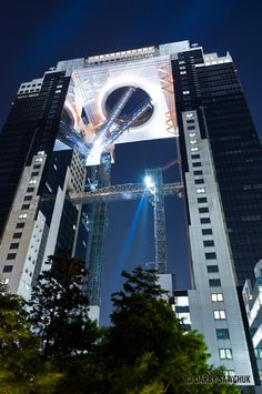 The futuristic Umeda Sky Building in Osaka, Japan at night.