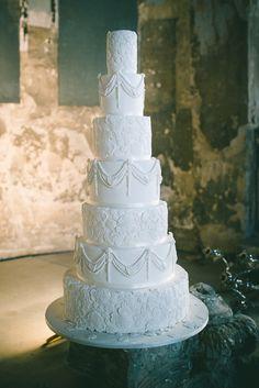 tall all-white wedding cake // photo by Babb Photo // http://ruffledblog.com/ee-cummings-inspired-halloween-shoot