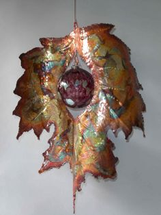 This is beautiful the way the different metals were melded and heated to create vibrant colors.