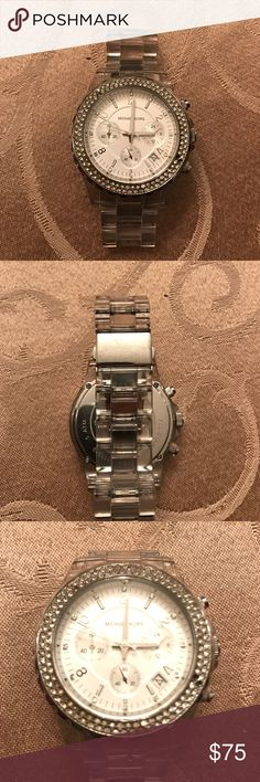 Michael Kors watch Silver and clear Michael Kors watch. Has some wear on it and 2 missing jewels on front as shown in picture. Needs battery, comes with extra links Michael Kors Accessories Watches