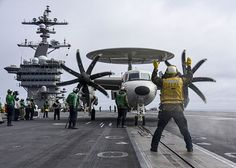 """An E-2C Hawkeye from the """"Black Eagles"""" of  Carrier Airborne Early Warning Squadron (VAW) 113  prepares to launch from the aircraft carrier USS Carl Vinson (CVN 70)."""
