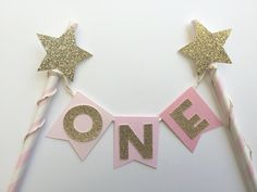 The Original Cake Bunting Topper in Pink OMBRE with Gold Glitter Stars and Letters.  Age Cake Topper.  1st Birthday Smash Cake.  Photo Prop by PaperTrailbyLauraB on Etsy https://www.etsy.com/listing/234198156/the-original-cake-bunting-topper-in-pink