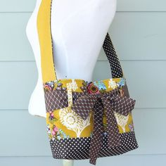 mini messenger bag - mustard floral, $65.00 by the pleated poppy