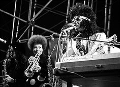 Jerry Martini, Cynthia Robinson and Sly Stone of the rock and roll group Sly And The Family Stone perform onstage at the Los Angeles Free Clinic Benefit in circa 1972, in Los Angeles, California.