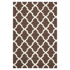 Wool rug with a dark brown and ivory trellis motif. Hand-tufted in India.  Product: RugConstruction Material: WoolColor: Dark brown and ivoryFeatures:  TuftedHandmade  Note: Please be aware that actual colors may vary from those shown on your screen. Accent rugs may also not show the entire pattern that the corresponding area rugs have.