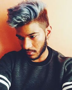 Men's hair and beauty.  Blue hair with a medium fade undercut.  Hair and beard.