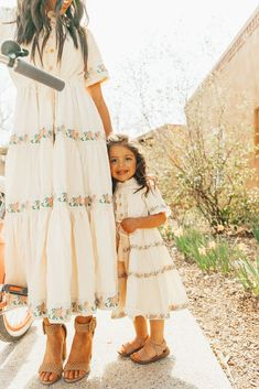 Our Santorini dress has a twin. The Holland Dress is a cream color with pink embroidered florals. Mommy And Me Dresses, Mommy And Me Outfits, Little Girl Outfits, Kids Outfits, Girls Dresses, Cute Little Girl Dresses, Summer Family Pictures, Family Picture Outfits, Boho Outfits