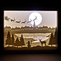 Find out how to make an amazing shadow box with light and a paper cut scenery!