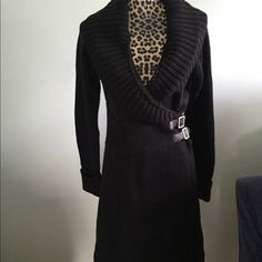 Victoria's Secret Sweater Dress Super warm black sweater dress, purge the in the winter with a pair of black stockings. Made very well and the dress itself has two snaps inside for support as well as a hook and eye and the buckles for fashion and security. Moda International Dresses Long Sleeve