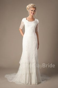 modest wedding dresses   Alexandra   LatterDayBride & Prom   Salt Lake City   Utah   Worldwide Shipping   This bohemian modest wedding dress features a detailed lace, half illusion sleeve and a darling scalloped scoop neckline and a darling tiered skirt.  Gown available in White, Ivory or Champagne/Ivory  *Gown pictured in Ivory  Sleeve length or neckline can be customized.