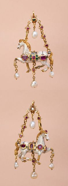 A Spanish gold and enamel horse pendant, circa 1600. The saddled horse, that once had a figure of Cupid sitting on its saddle, is set with rubies on one side, on the other with emeralds and hung with pearls. There is a charming detail in its making: the raised leg is hinged so that when moved, the horse appears to be pawing the air. Height 8.3cm, depth 4.2cm.