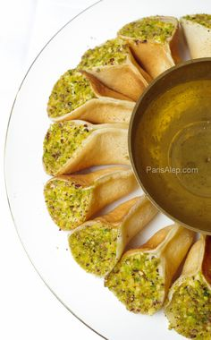 A great Middle Eastern dessert -SYRIAN crepes (atayef 'assafiri). Get al the traditional Syrian ingredients from the stores listed in the GROCERY SHOPPING GUIDE at the All About Cuisines web site.#Syrian Food #Syrian Recipes
